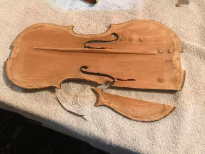 The-small-pieces-are-purfling-a-narrow-decorative-edge-inlaid-into-the-top-plate-of-fiddles..jpg