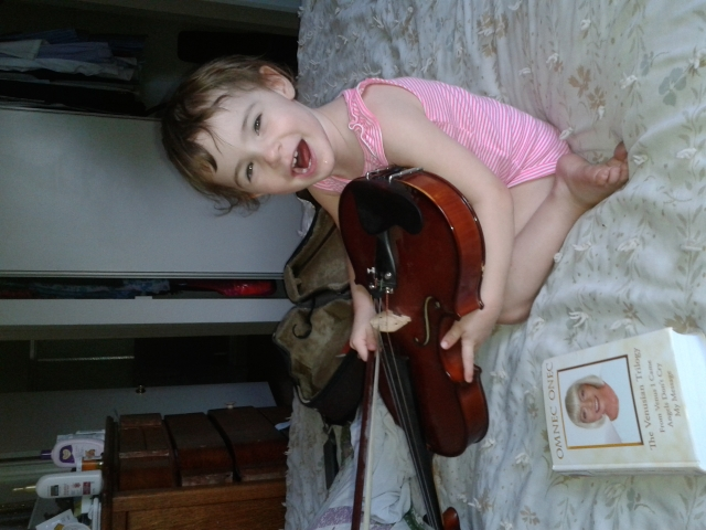 carrie-playing-violin-with-bow.jpg