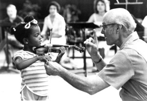 John D Kendall teaching a young violin student