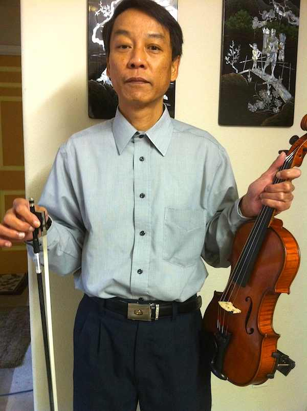 "Robert - known as ""ratvn"" with his favorite violin."