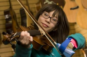 Disability necessitating playing a left hand violin.